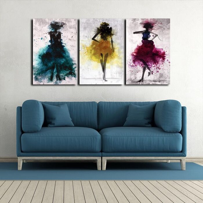 three piece wall art summer decor pieces over a blue sofa in a living space