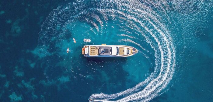 yachting summer a large yacht seen from above in a circle in the middle of the sea