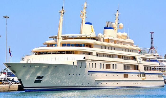 al said luxury yacht outside in a port large white and blue yacht