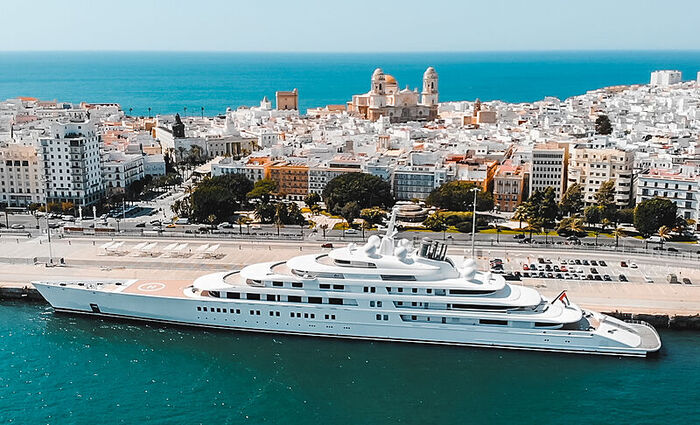 azzam yacht large luxury yacht with beautiful port town in the background