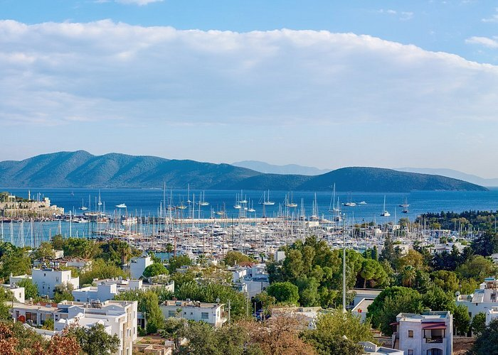 bodrum city with boats in the background and a mountain range