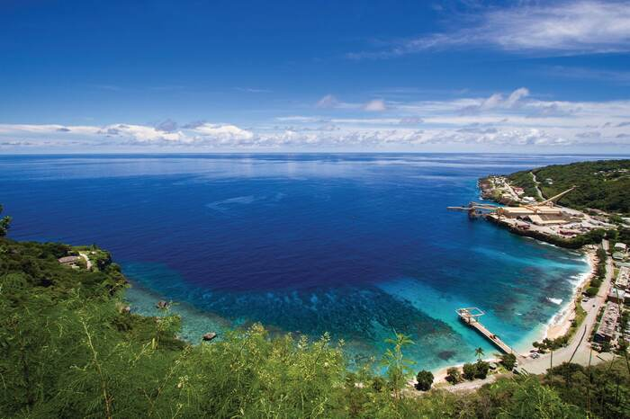 christmas island in Australia beach with beautiful blue water peers and blue sky with horizon