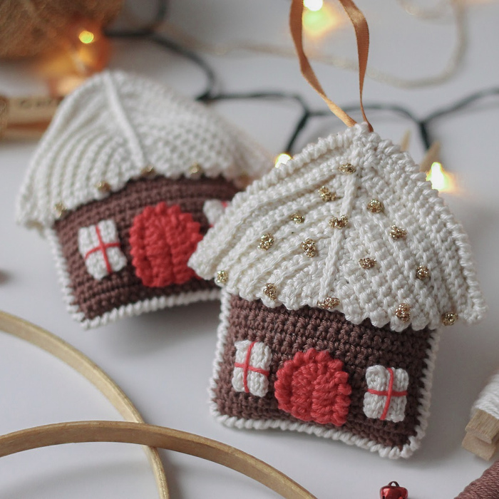 crochet christmas ornaments in the form of cute houses on a table
