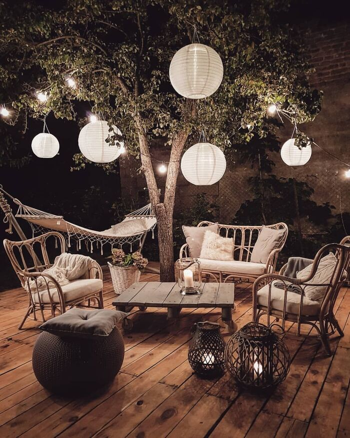 cozy outdoor area with large oval lanterns hammock and garden furniture