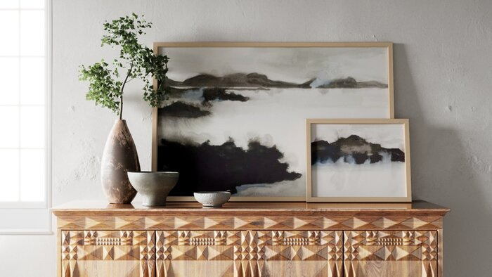 design pieces paintings on a decorated wooden piece of furniture with other accent pieces