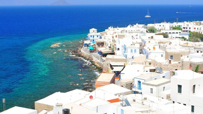 Dodecanese greek islands with white houses and beautiful blue sea around yachts in the sea