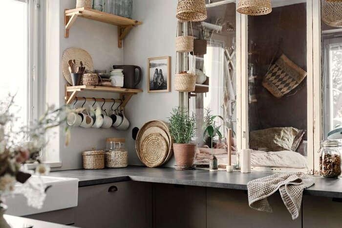 earthy tones and materials in a kitchen setting with large window and stone countertop