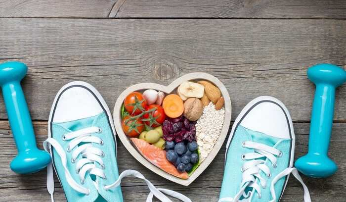 healthy life fitness and diet blue sports shoes heart shaped bowl with healthy foods