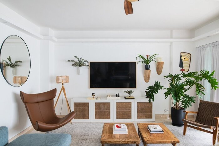 interior design living room interior with natural materials large tv on the wall and green living plants