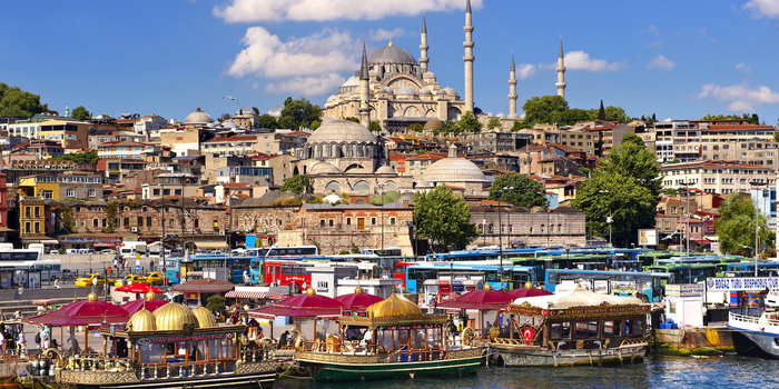 visiting Turkey a tourist picture from Istanbul with a large mosque in the background and boats in front
