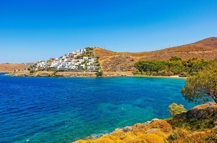 Kea island in Greece beautiful blue sea with cliffs and houses on them surrounded by trees