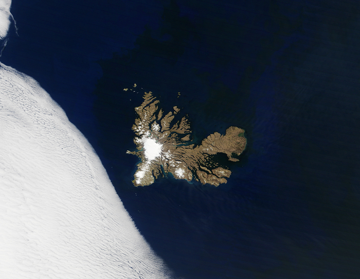 kerguelen island a spot in the large ocean with snowy tops close to a snow field remote islands