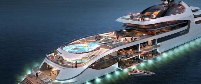 luxury yacht with lights on in the middle of the sea with a large pool