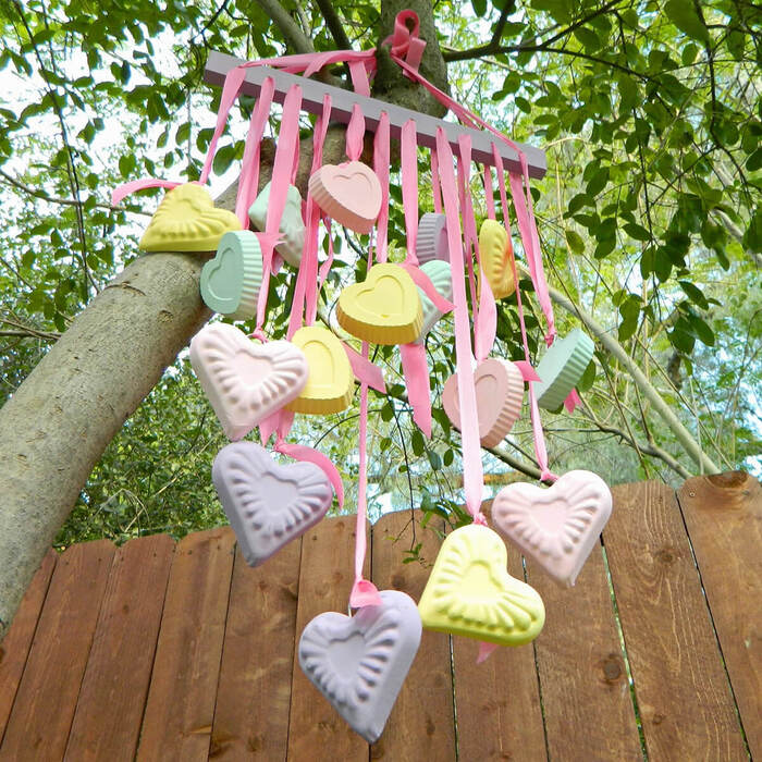 outdoor heart decor colorful bunch of hearts hanging from a tree outside