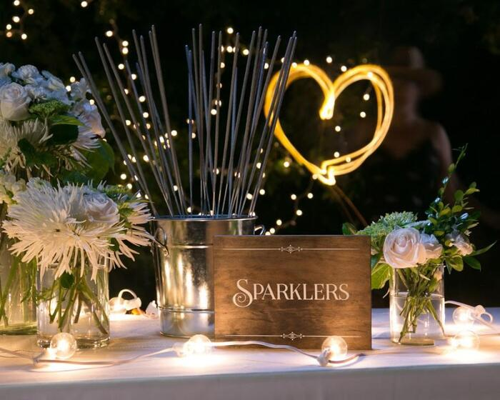 party sparklers beautifully decorated table with flowers and lights