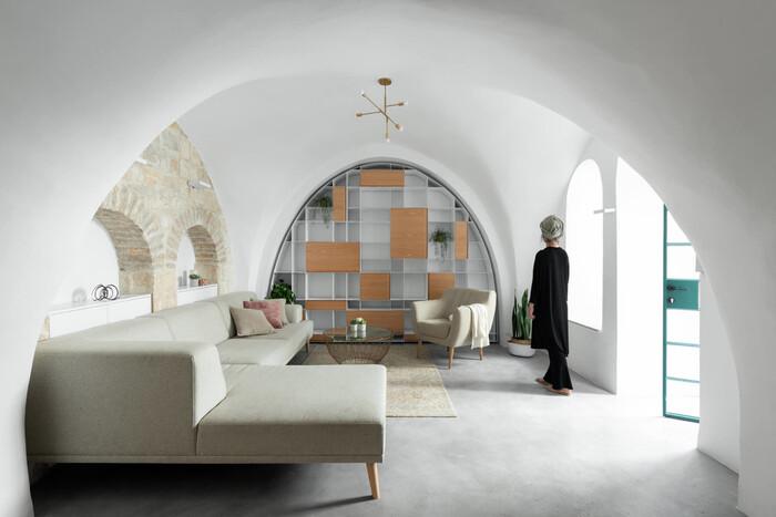 sleek modern design white cave room with creamy sofa and sleek furniture