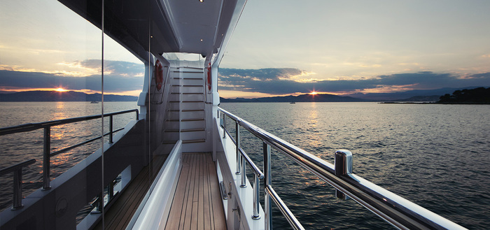 private yacht interior little corridor overlooking the sea with staircase in front