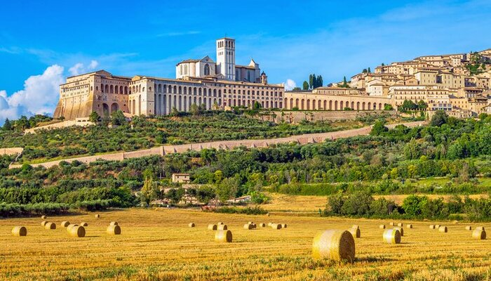 Landscape view from the fields surrounding Assisi and large buildings in the background