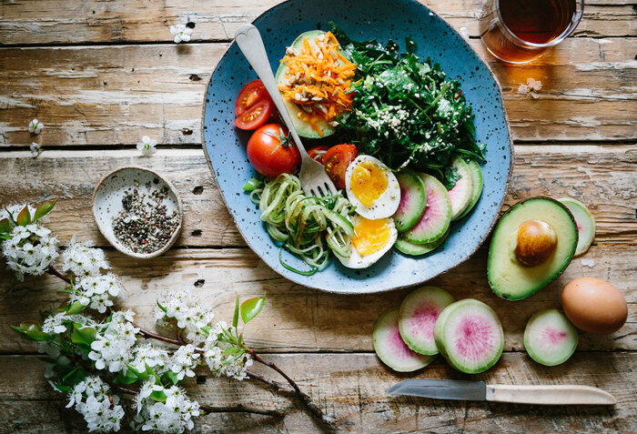 low blood pressure foods healthy meal arranged on a wooden table with a branch of blossoms on the side