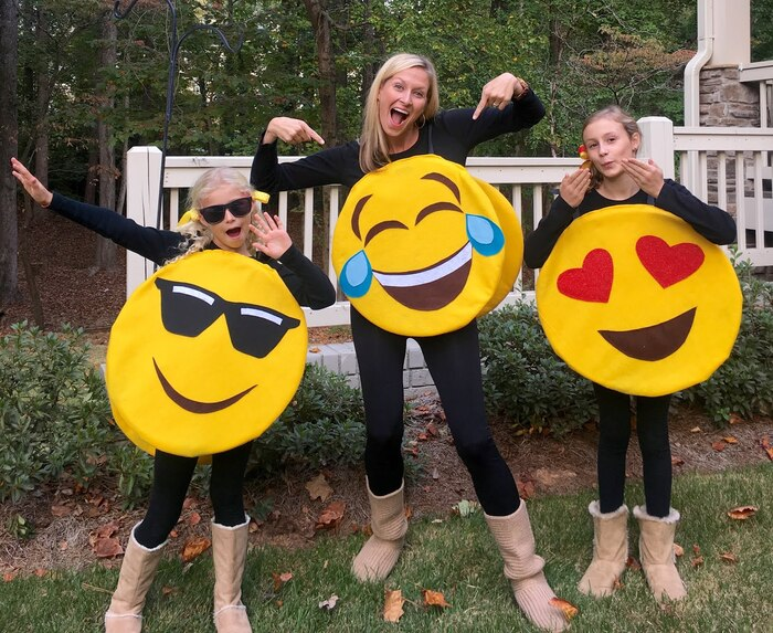 mom and her two girls dressed in no sew halloween costume emojis posing outdoors