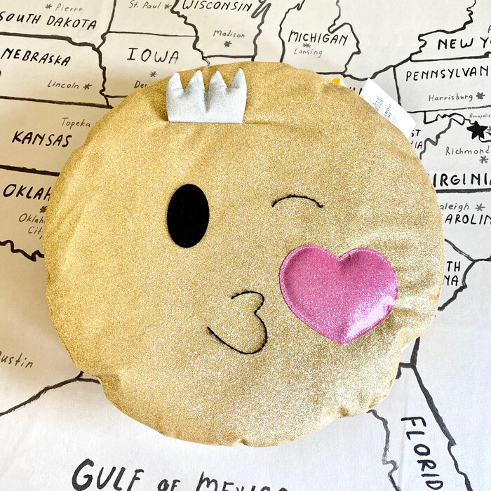 cute heart kiss emoji on a black and white map of the USA in the background