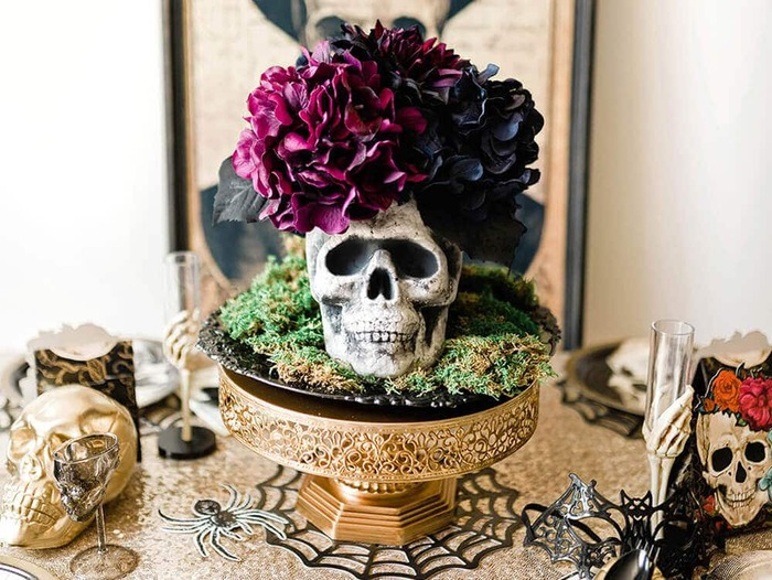skull flowers skull flower table centerpiece on a golden stand in the middle of a table