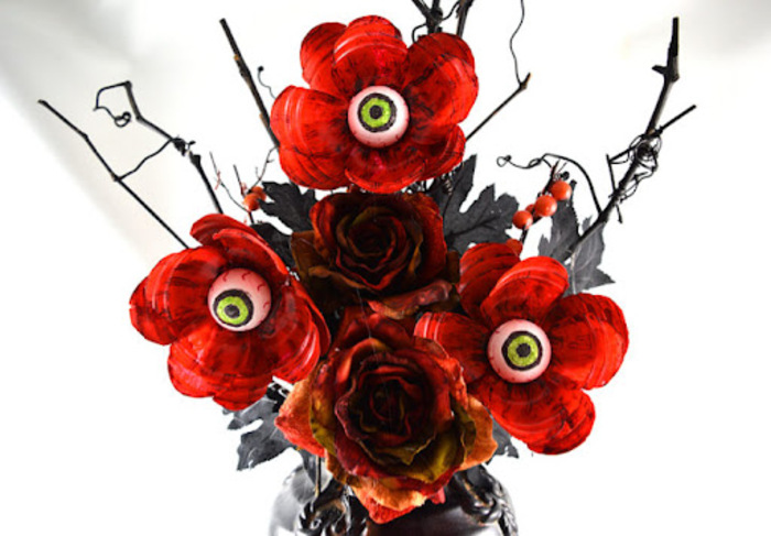 spooky flowers halloween flower arrangements with candy red roses with eyeball candy in the middle